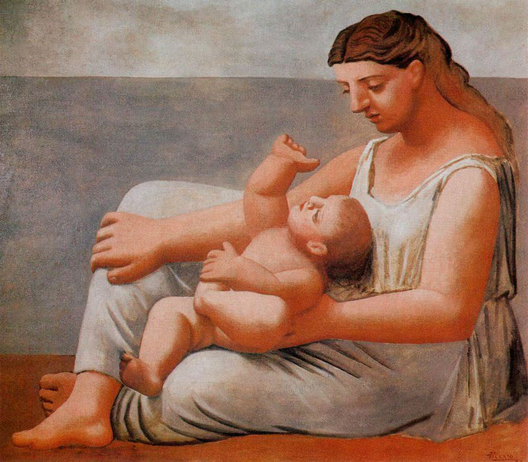 Woman with child on the seashore