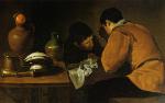 Dos jóvenes a la mesa